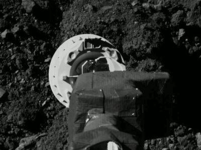 OSIRIS-REx arm near Bennu